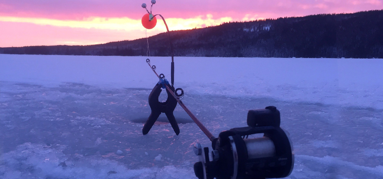 Fishing in the ice in the Swedish Lapland